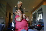 Janine Anderson (cq) is embraced by her husband Richard Anderson (cq), the man who has cared for...