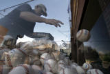 (003) Phil Pettit of Star West Productions throws a baseball into a bin in preparation for a press...