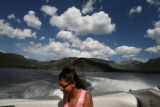 (PG04119) Skyler Scott, 18, sits on the back of the family boat on Grand Lake on Thursday, July 3,...