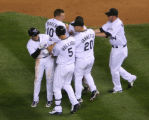 Rockies Ryan Spilborghs, left, is congratulated by team members after driving in two run in the...