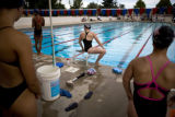 Melissa Stockwell (cq) waits to jump into the pool during a swim meet. Stockwell was seconds away...