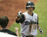 05/26/2008  TULSA, OK    Tulsa's Jeff Dragicevich is welcomed back to the dugout after hitting a...