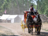 Volunteer Eric Ballotti (cq) drives a 1940's era stagecoach at the old-fashioned July 4th...