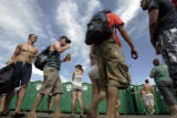 Festival goers wait to use portable restrooms during Mile High Music Festival at Dick's Sporting...