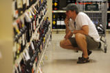 DM0111  Brent Anderson of Denver checks out the wine selection at Applejack Liquors on the first...