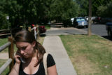 Danielle Swansen (cq) stands outside her former residents at 995 Marine St. Swansen returned from...