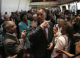 The Rev. Jesse Jackson greets people who listened to him preach at the Friendship Baptist Church...
