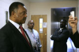 The Rev. Jesse Jackson answers reporters questions after he preached at the Friendship Baptist...