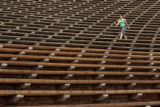 Roberta Farley (cq), Denver, walks the seats at Red Rocks, Monday morning July 14, 2008, Denver....