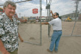 BG_0040 Stew Jackson, left, owner of the buses, and an unidentified man close the gates to the...