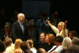 Republican Presidential candidate, John McCain, left, listens to Georgette Haddad, 70, of Golden,...