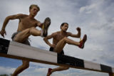 Billy Nelson (cq) and Pete Janson (cq) jump over a barrier at the photographers request. Janson...