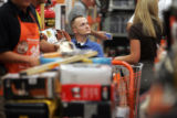 Matt Keil watches as power tools are loaded into a shopping cart at Home Depot in Parker on...