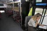 DM0058  RTD bus driver Elaine Patterson waits for rider at the Arapahoe Station while driving the...
