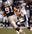 (DENVER, Co., SHOT 10/17/2004) The Denver Broncos' Jake Plummer (#16, QB) looks to pass downfield...