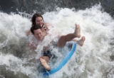Mia Anderson, 26, of Denver, and Jeff Bronzetti, 33, of Denver, tube at Confluence Park in Denver,...