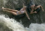 Jen Lock, 24, of Highlands Ranch, and Justin Grube, 24, of Denver tube at Confluence Park in...