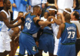 (Denver,CO,Shot On 4/27/04-- Nuggets Carmelo Anthony(right) and Timberwolves Ervin Johnson...