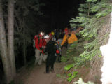 Here are a couple different pictures showing the rescue of Father Edward M. Hoffmann in Grand...