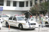 A protesters runs over a police vehicle in downtown St. Paul before the start of the Republican...