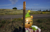 A memorial sits on CR 49 in Hudson, CO, where Adriana Ronquillo and her husband Jose Bencomo,...