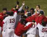 BXF154 - Boston Red Sox's David Ortiz is mobbed by teammates after hitting the game-winning homer...