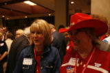 Colorado delegates Sue Sharkey, left, of Windsor, and Marty Neilson, center, of Lyons, wait and...