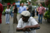 Johnny Dendy of St. Paul watches the crowds in downtown on the second day of the Republican...