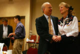 Karl Rove talks with Perry Buck, vice-chairman of the Colorado Republicans, before speaking to the...