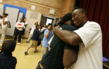 DM4154  Brandon Marshall hugs Rev. Leon Kelly as he arrives for a visit at the Open Door Youth...
