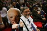 Alaska delegate Paul Verhagen holds up a puppet with the face of John McCain on it early in the...