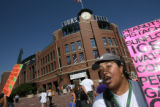 Marta Lara (cq) sells pistachios, peanuts, and beverages outside of Coors Field on Wednesday,...