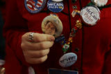Colorado delegate Kimberly Peticolas holds up her Ronald Reagan pin on the final day of the...