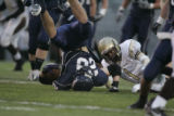 #28 Kevin Richards (cq) is tackled by #1 Brandon Lowe (cq) as the Columbine Rebels football team...