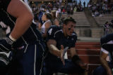 #4 Danny Spond (cq) high fives teammates as the Columbine Rebels football team beats the Thomas...