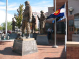 CXCL_Gary: Jim Stuart repairs a brochure hoder at Pueblo's Plaza of Heroes honoring the city's...