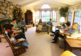 The Johnson family starts the day with a bible reading in their living room at 6:30 in the...