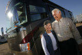 DM0300  Ken and Judy White pose for a portrait with their recreational vehicle near their home in...