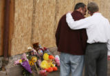 MJM356 Vito Kudlis (cq) of Aurora, Colo., center right,   mourns the death of his son, Marten...