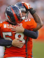 DM1880  Denver Broncos quarterback Jay Cutler #6 gets a hug from linebacker Nate Webster #58 after...