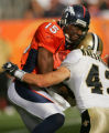Brandon Marshall is hit by Kevin Kaesviharn in the third quarter of the Denver Broncos against the...