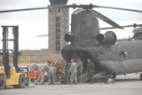 Members of the 2nd Battalion, 135th Aviation Regiment, Colorado Army National Guard, load supplies...
