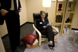 Corri Spiegel (cq) Economic Development Manager of Centennial sits in IKEA's signature PO€NG chair...