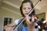 Bethany Johnson practices violin. Lisa and Dale Johnson have 8 kids, ages 7-23 -- and all of them...