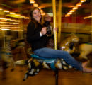 (Denver, Colorado, Sept. 5, 2008) Xenia Belousova rides with friends on the merry-go-round. ...