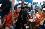 DM5531  Will Boone, 8, isn't sure what to make of Raider Nation representative Michael Stokes as...