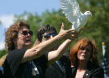Mother Michelle Benavidez releases a single dove at the funeral service for her son Staff Sgt....