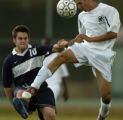 (Aurora, Colo., October 4, 2004) Aurora Central High School forward Guerra Gerardo, right, fights...