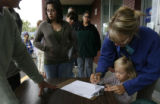 Ava Swanson (cq) and her mother, Adrienne Swanson (cq) sign up on a waiting list to become...