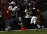 JOE0358 Denver Broncos kicker Matt Prater (5) chases San Diego Chargers Darren Sproles (43) during...